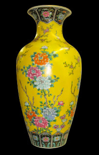 A restored monumentally sized Chinese hand painted vase. The yellow vase is adorned with hand painted flowers and ornamentation.